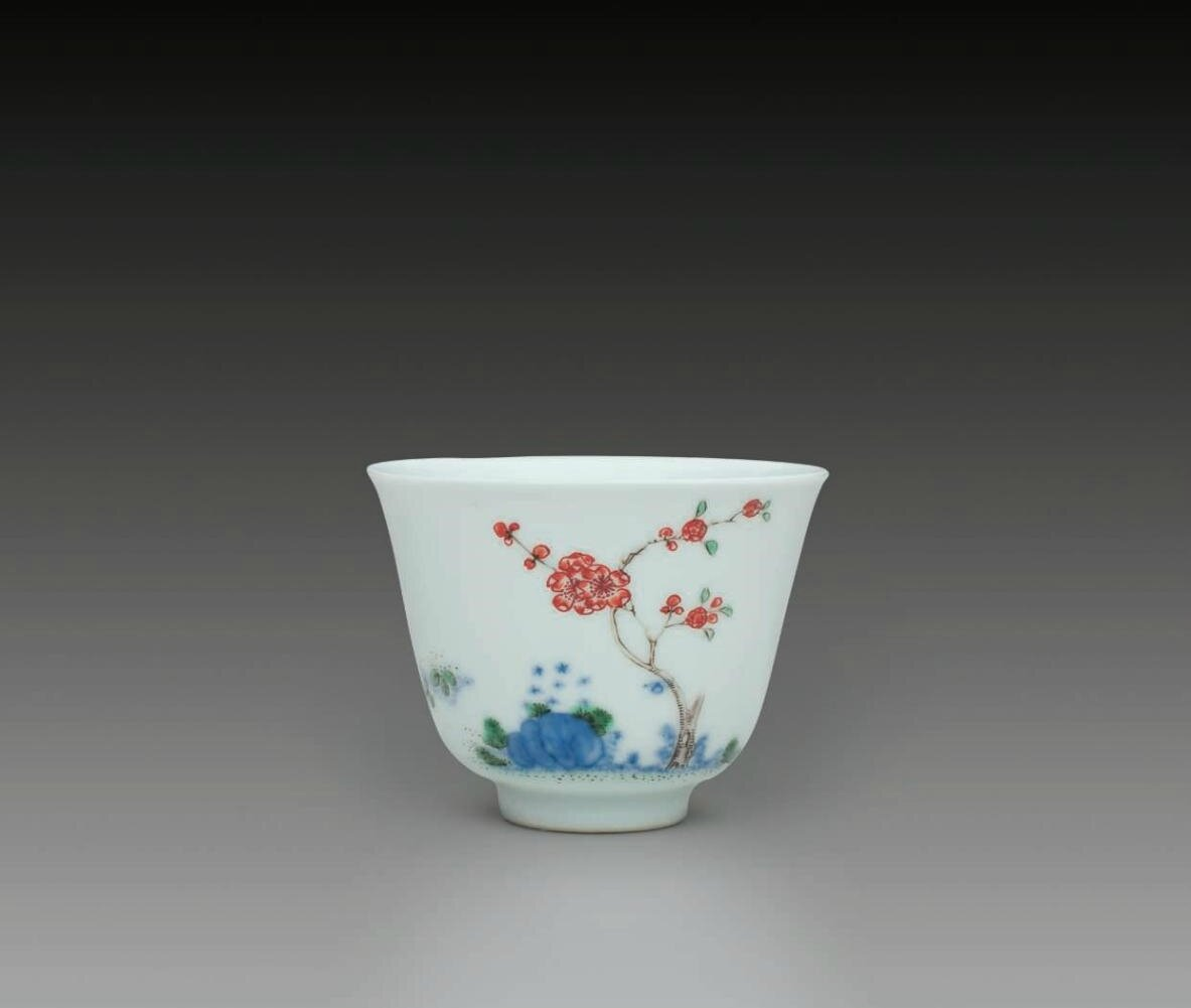 A famille verte 'Apricot blossom' 'Month' cup, Kangxi six-character mark in underglaze blue within a double circle and of the period (1662-1722)