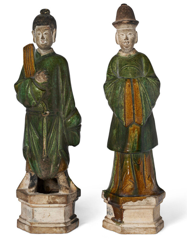 A pair of green and amber-glazed pottery figures of attendants, Ming dynasty (1368-1644)