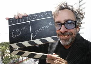 485839_director_tim_burton_jury_president_of_the_63rd_cannes_film_festival_holds_a_film_clapper_in_cannes