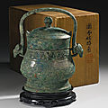 An archaic bronze ritual wine vessel and cover (you), early western zhou dynasty, 10th century bc
