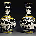 A pair of grisaille-decorated black-ground vases, guangxu six-character marks in underglaze blue and of the period (1875-1908)