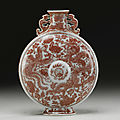 A rare copper-red 'dragon and phoenix' moonflask, jiaqing seal mark and period (1796-1820)