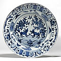 A rare blue and white dish for the portuguese market, ming dynasty, wanli period, circa 1590