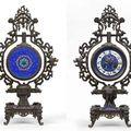 L'escalier de cristal. pendule en bronze à décor chinoisant. le cadran émaillé.. epoque xixème siècle.