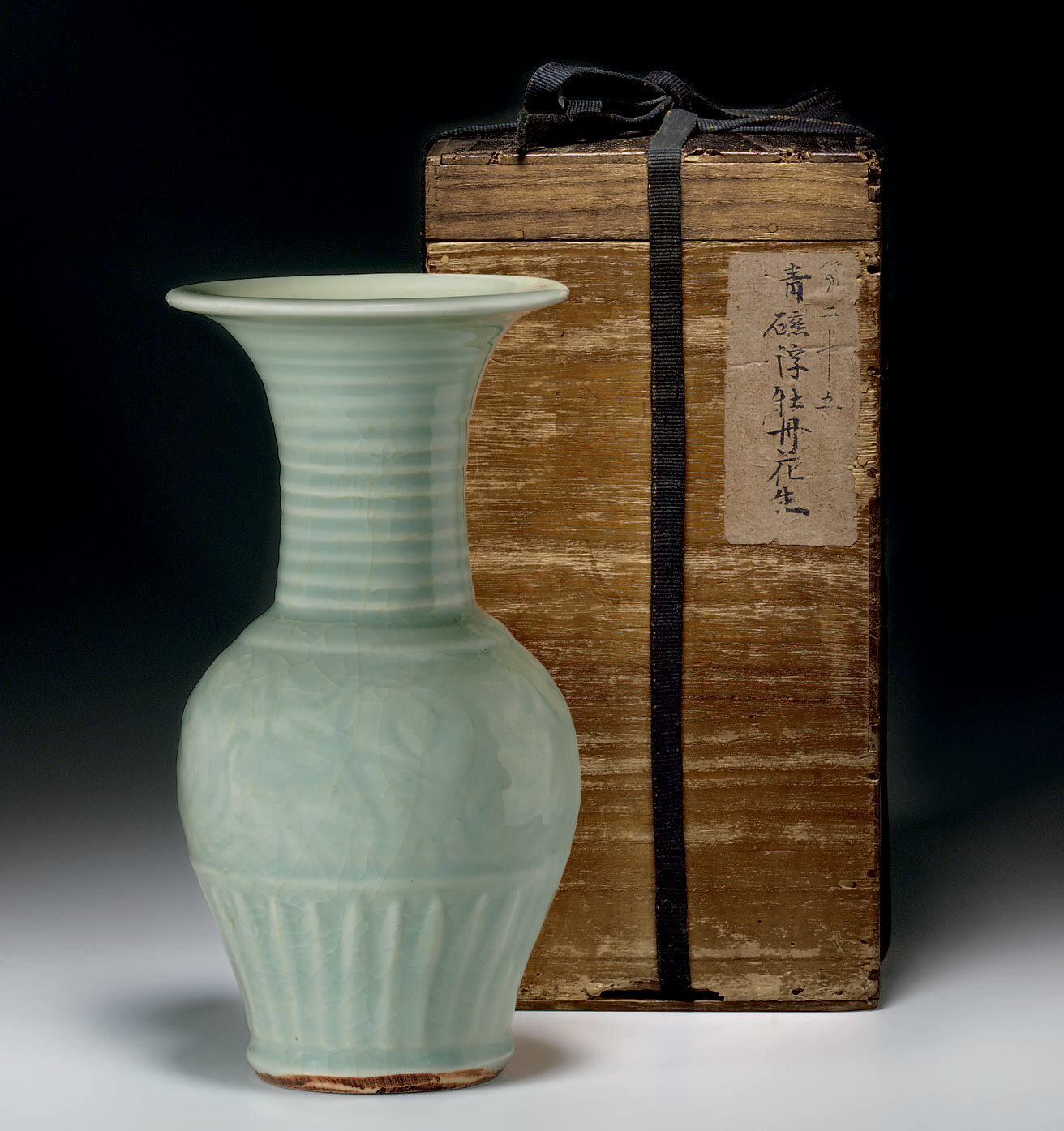A rare small Longquan celadon trumpet-necked baluster vase, Southern Song-Yuan dynasty, 12th-13th century
