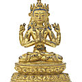 A rare gilt-copper figure of avalokiteshvara chaturbhuja, nepal, 14th-15th century