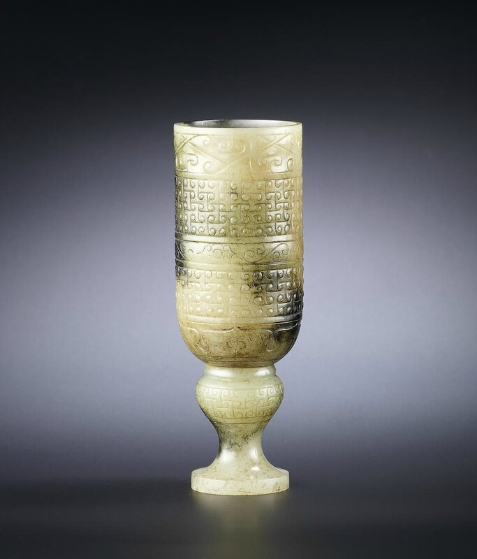 A rare yellowish-grey and black jade stem cup, Western Han Dynasty