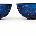A pair of carved blue glass bowls, Qing dynasty, 19th century