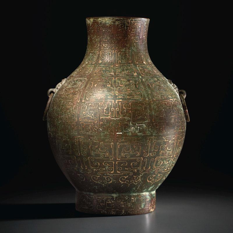 2021_NYR_19547_0711_000(a_very_rare_copper-inlaid_bronze_jar_hu_warring_states_period_5th_-_ea010605)