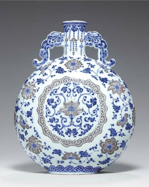 An unusual copper-red and blue and white moon flask, Qianlong period (1736-1795)