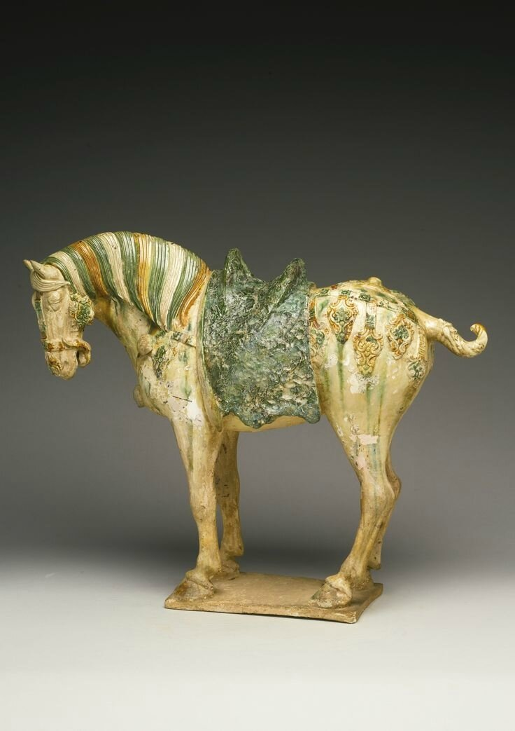 A sancai-glazed pottery figure of a caparisoned horse, Tang dynasty (618-907)