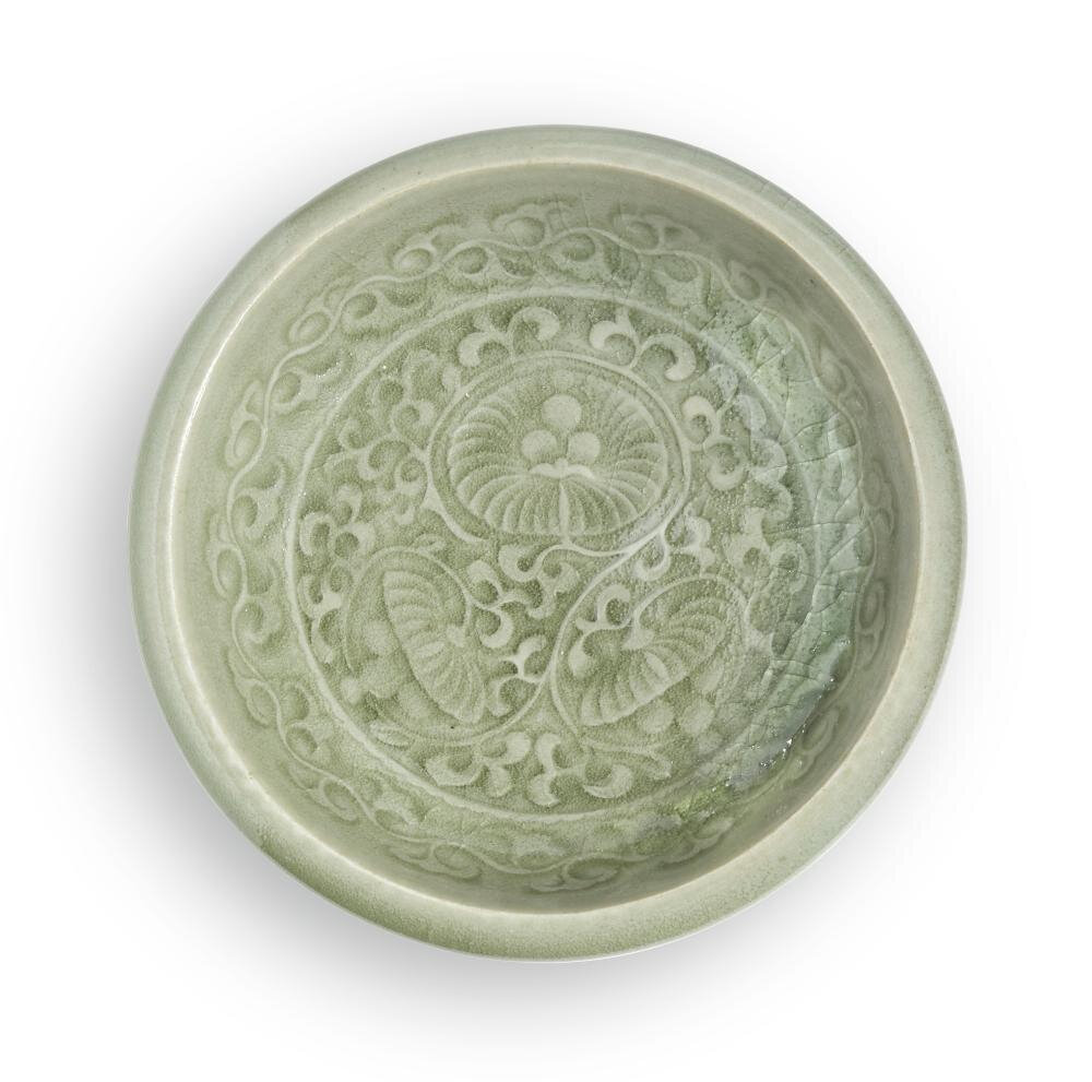 A carved 'Yaozhou' celadon dish, Yuan-Early Ming dynasty
