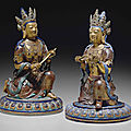 Two gilt and enameled porcelain figures of bodhisattvas, qianlong-jiaqing period (1736-1820)