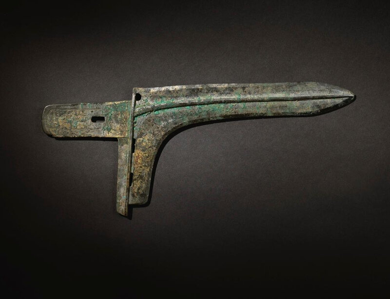 An exceptionally rare and important archaic bronze ceremonial halberd blade (ge), Eastern Zhou dynasty, early Spring and Autumn period
