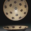 A Jizhou resist-decorated paper-cut conical bowl, Southern Song Dynasty, 12th-13th century 1