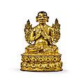 A gilt-bronze figure of a lama, ming dynasty, 15th-16th century