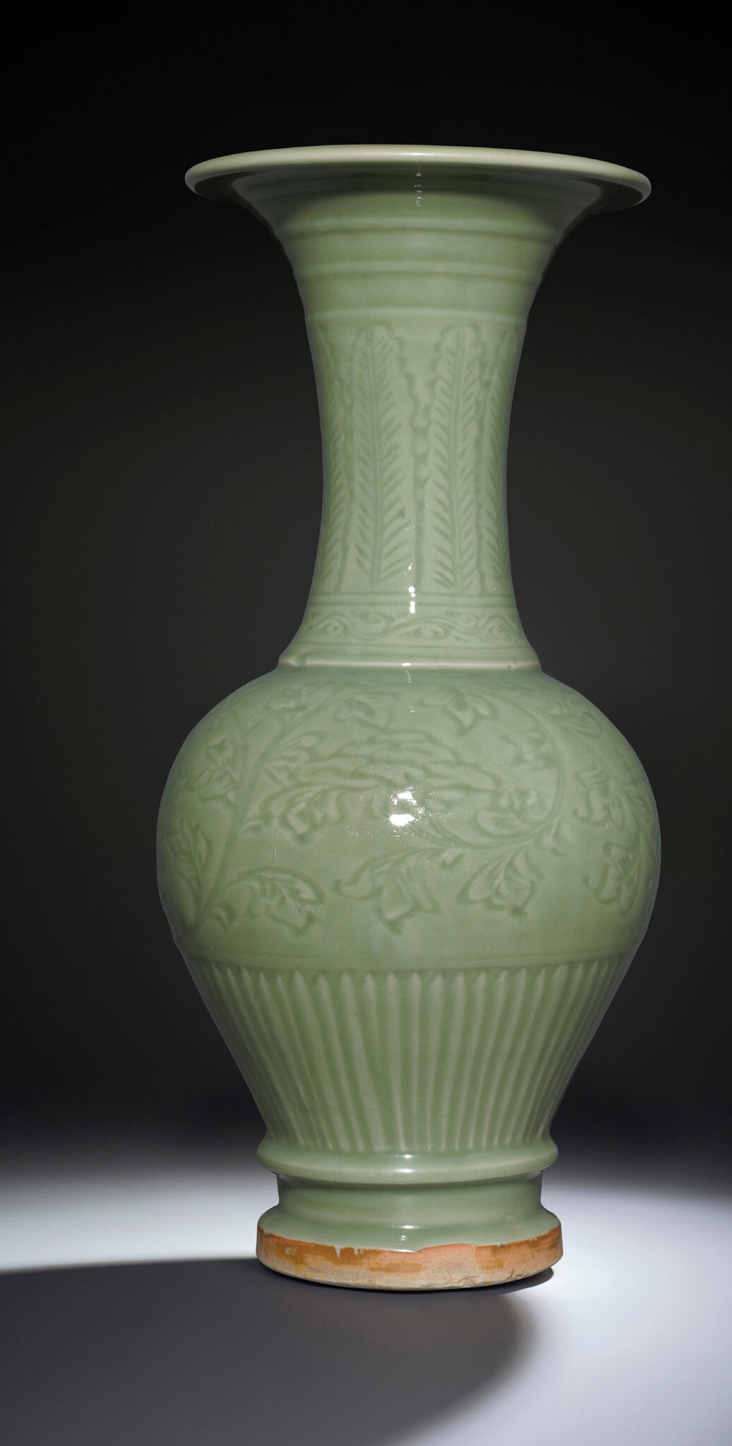 A carved Longquan celadon temple vase, Ming dynasty, 14th-15th century
