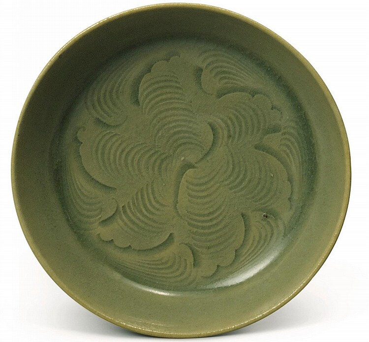 A small carved 'Yaozhou' saucer dish, Northern Song dynasty (960-1127)