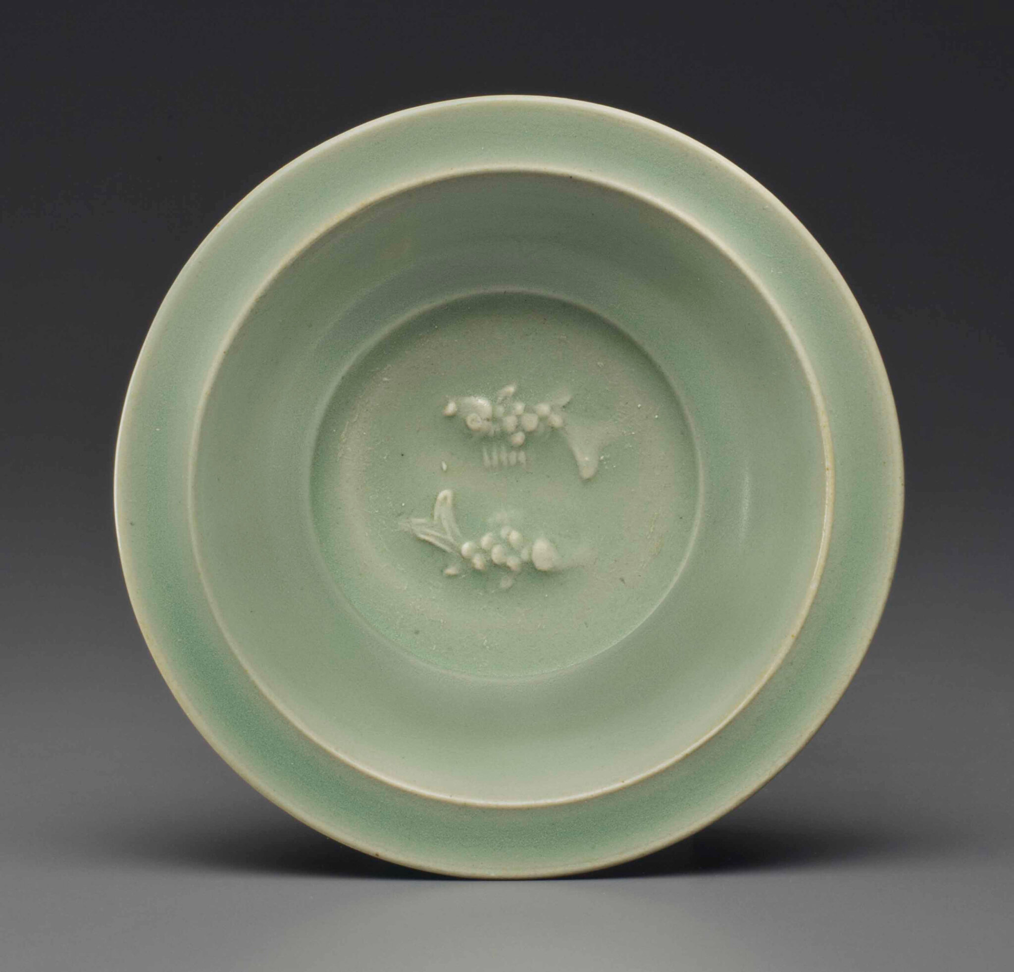 A small Longquan celadon 'twin fish' dish, late Southern Song-Yuan dynasty, 13th-14th century
