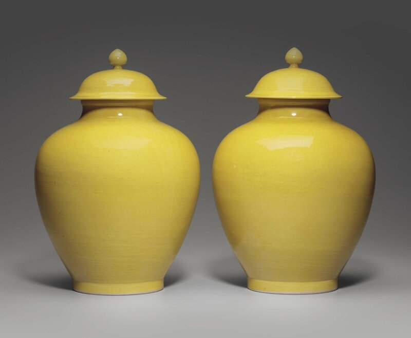 A pair of yellow-glazed jars and covers, Daoguang six-character incised seal marks and of the period (1821-1850)