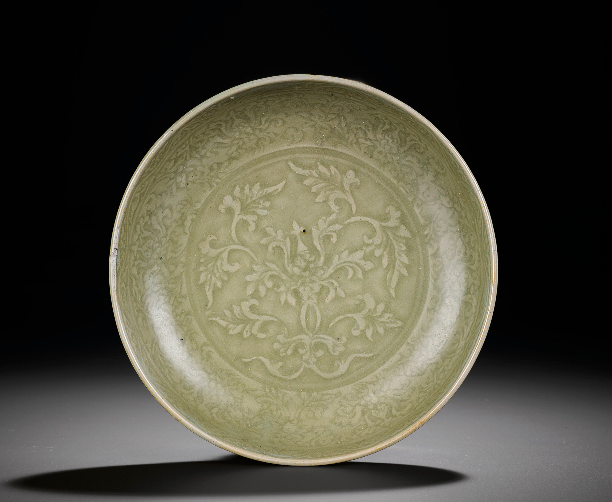 A Longquan celadon moulded 'lotus' dish, Ming dynasty, late 14th-early 15th century