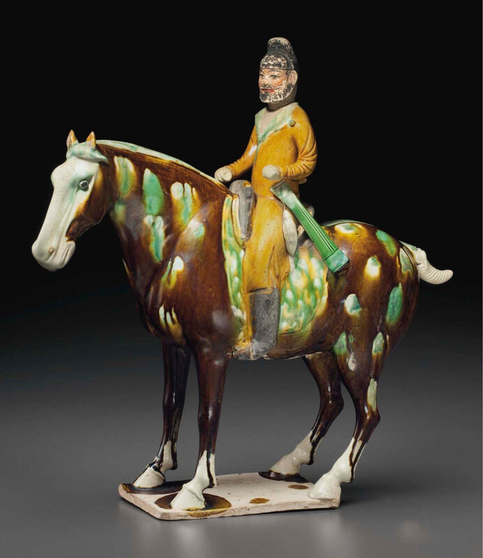 2015_NYR_03720_3228_000(a_superb_and_very_rare_painted_and_sancai-glazed_pottery_figure_of_an)