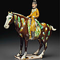 A superb and very rare painted and sancai-glazed pottery figure of an equestrian hunter, tang dynasty (ad 618-907)