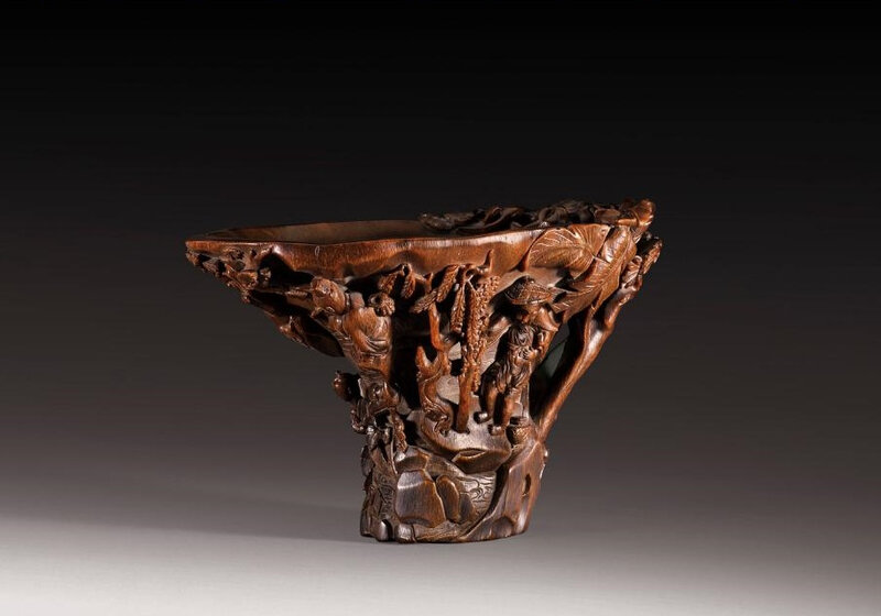 A carved rhinoceros horn libation cup, China, Qing dynasty, 17th-18th century