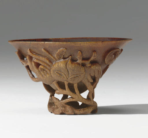An unusual small rhinoceros horn libation cup, 17th century