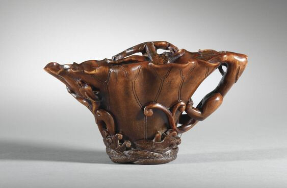 A carved rhinoceros horn 'chilong' libation cup, China, Qing Dynasty, 17th century