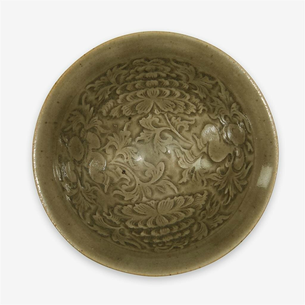 A Chinese 'Yaozhou' celadon glazed 'boys' tea bowl, Northern Song dynasty (960–1127)