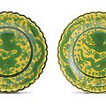 A pair of yellow-ground green-enamelled 'dragon' foliate dishes, Seal marks and period of Qianlong