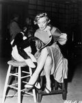 1952_MonkeyBusiness_Dressed_YellowDress_OnSet_withMonkey_040