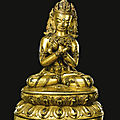 A gilt-bronze figure of vajradhara, tibet, 14th-15th century