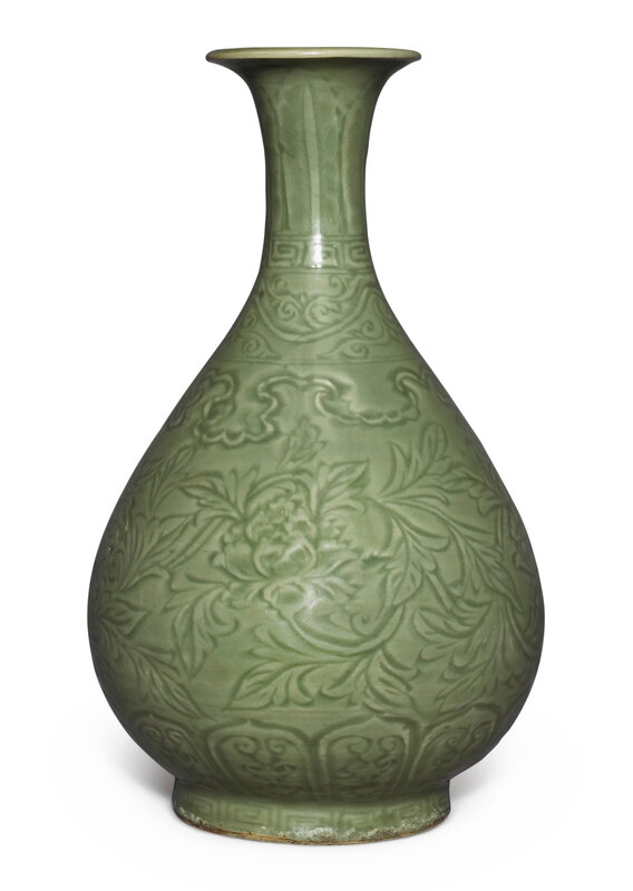 A finely carved 'Longquan' celadon-glazed 'peony' bottle vase, yuhuchunping, Ming dynasty, Hongwu period (1368-1398)