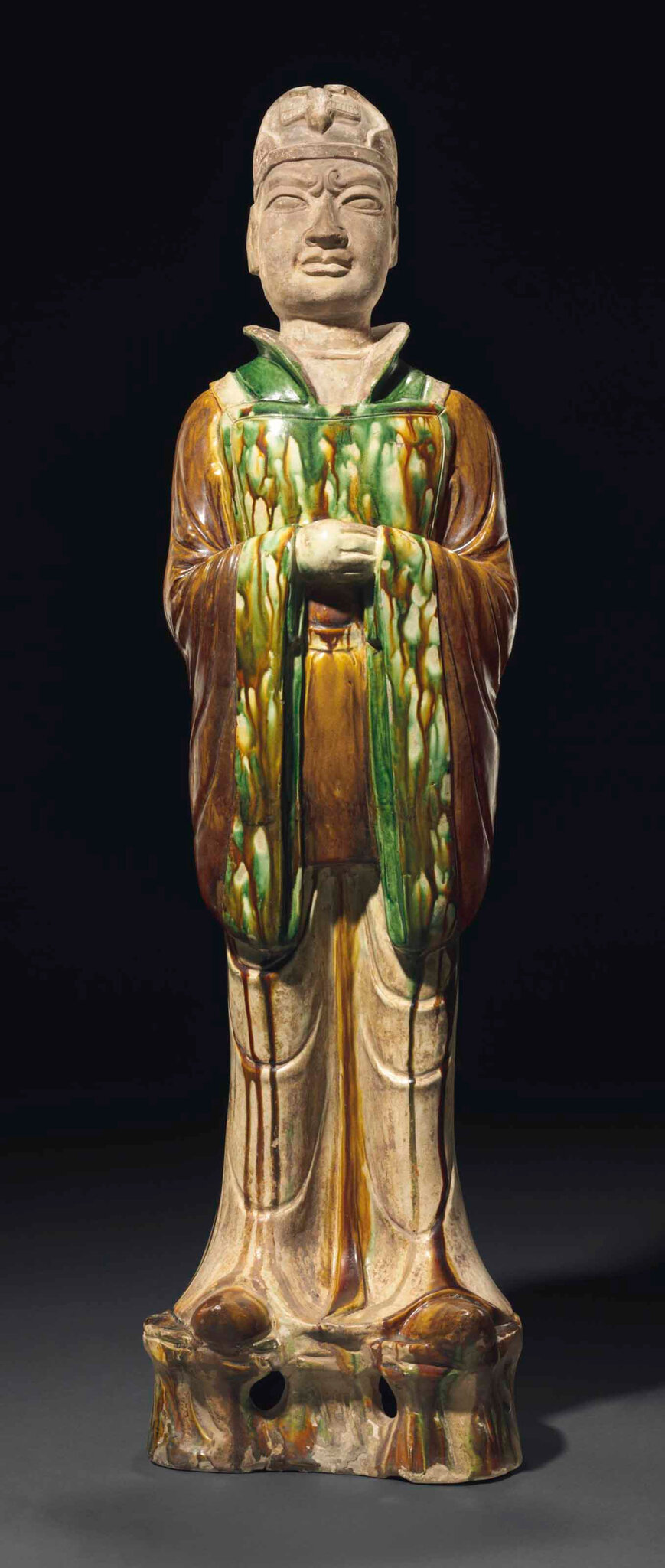 Asancai-glazed pottery figure of an official, Tang dynasty (AD 618-907)