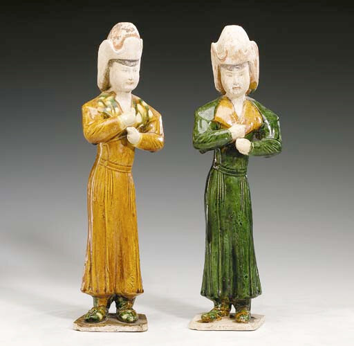 A Pair of Sancai-Glazed Pottery Figures of Falconers, Tang Dynasty (618-906)