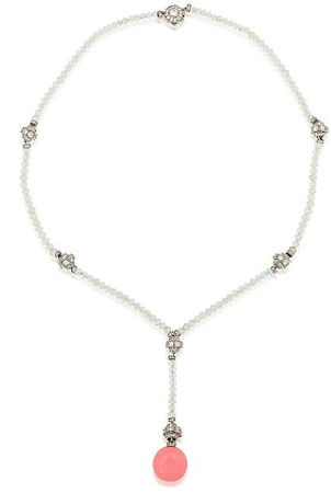 A_rare_natural_conch_pearl_and_diamond_necklace