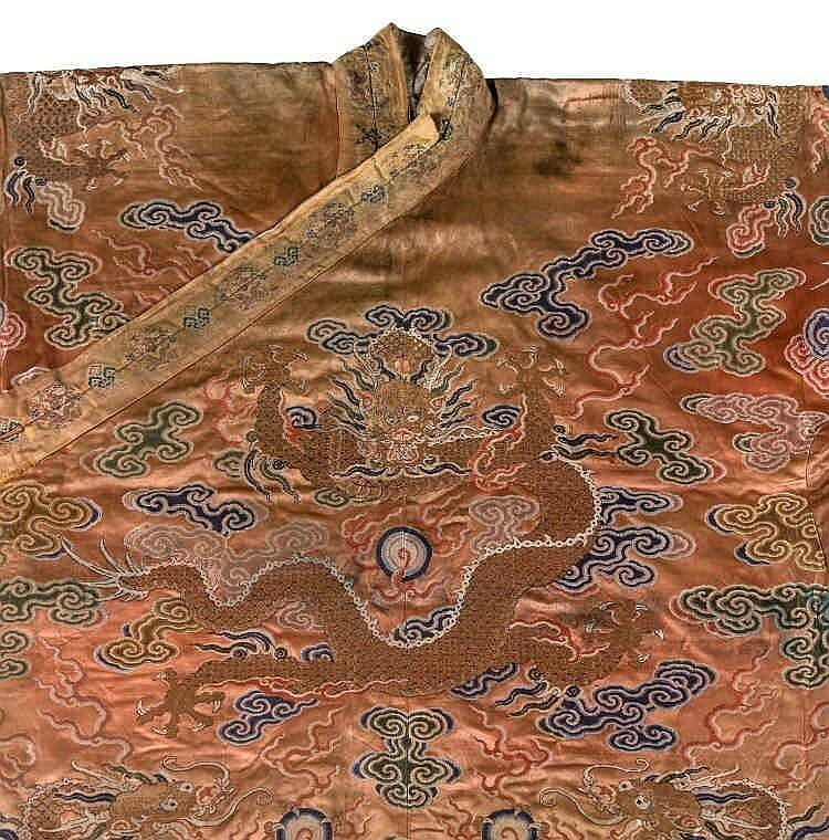 A coral ground silk Tibetan chuba, tailored from 18th century Chinese kesi6