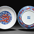 A pair of iron-red-decorated blue and white 'dragon' dishes, qianlong seal marks and of the period (1736-1795)