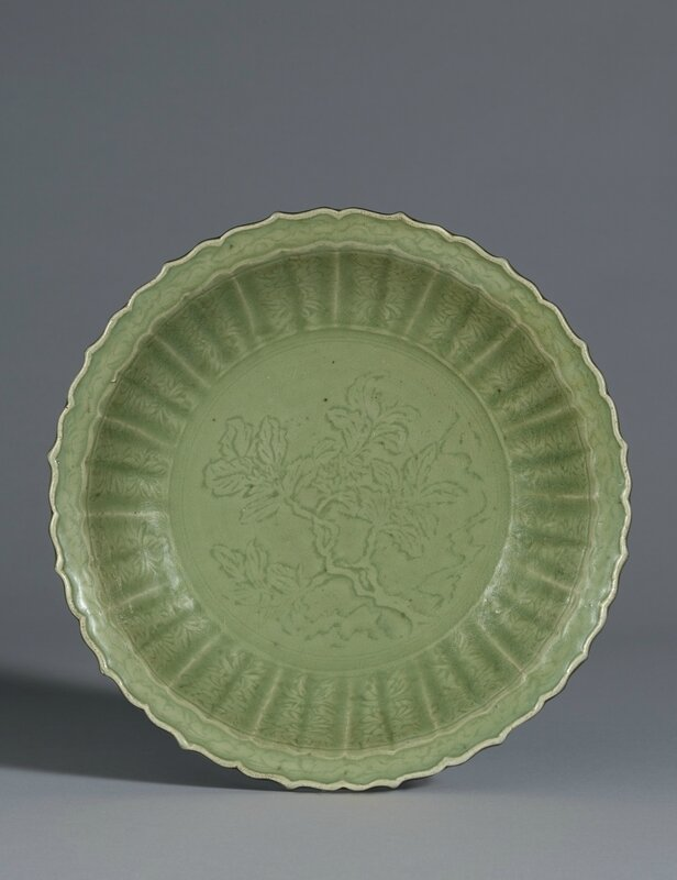 A large Longquan celadon barbed-rim dish, early Ming dynasty