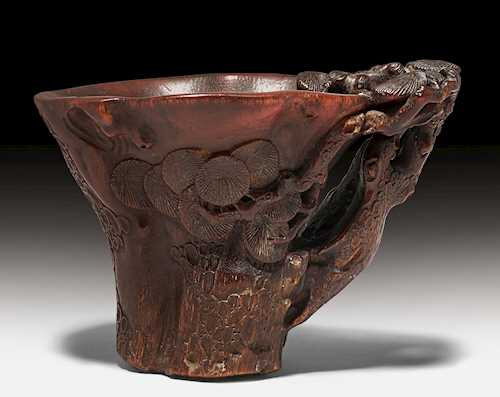 """A finely carved rhinoceros horn """"pine"""" libation cup, China, 17th century"""