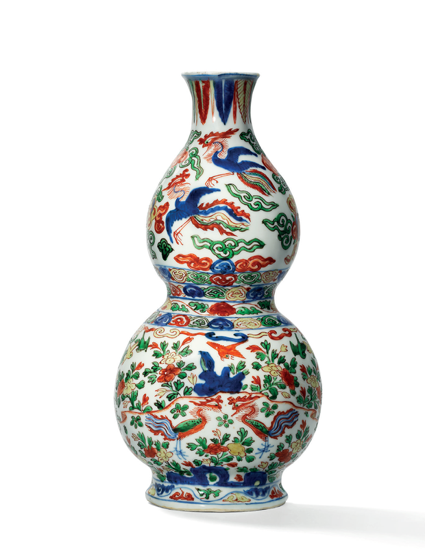 A rare wucai 'phoenix' double-gourd form wall vase, Wanli six-character mark in underglaze blue within a double rectangle and of the period (1573-1619)