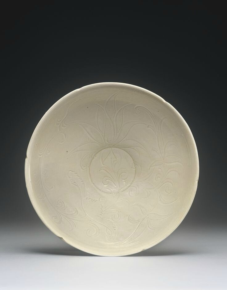 A carved 'Ding' 'Lotus' bowl, Northern Song dynasty1