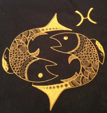 les poissons brodé sur du coton noir