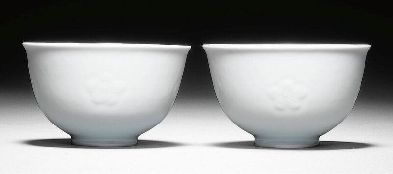 A very rare pair of moulded white-glazed bowls, Yongzheng seal marks and period (1723-1735)