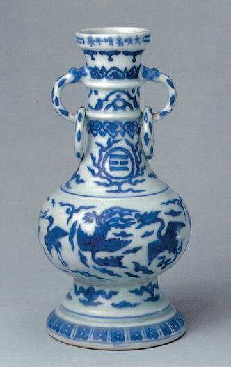 A blue and white 'phoenix and cranes' vase, Jiajing six-character mark in underglazed blue in a line and of the period (1522-1566)