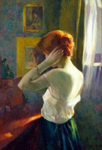 Femme rousse devant son miroir